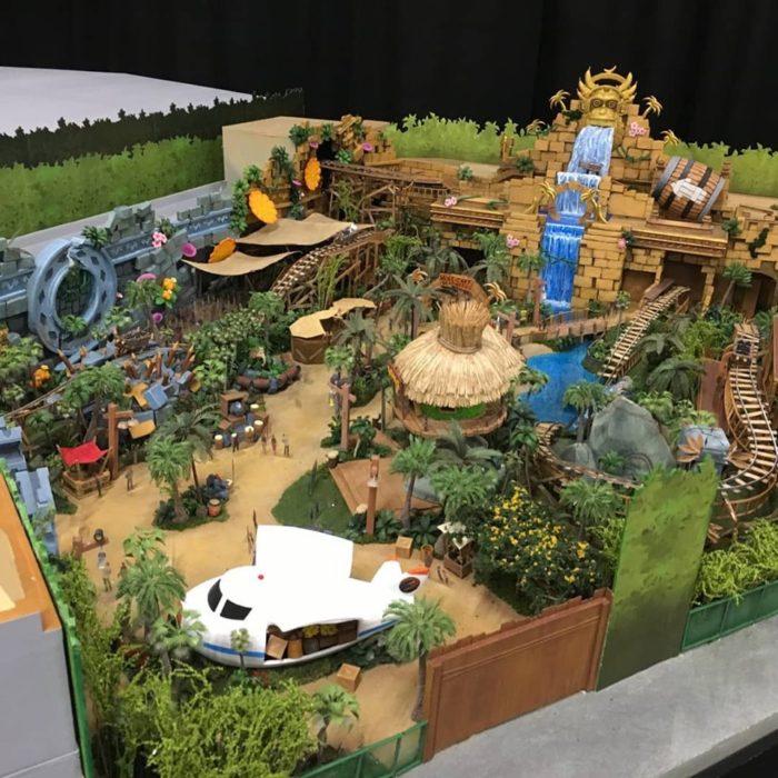Conceito artístico da área Super Nintendo World com a montanha-russa de Donkey Kong e o restante da área temática do videogame.