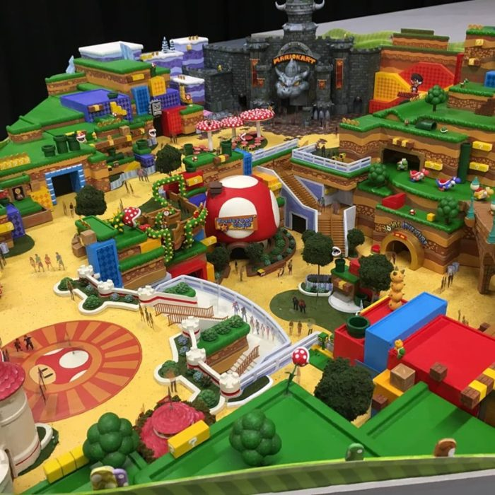 Conceito artístico da área Super Nintendo World mostrando o castelo do Bowser e outros elementos de Super Mario.