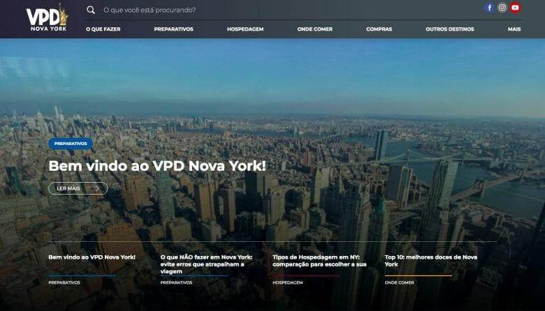 Foto da tela do site VPD Nova York, com uma imagem dos prédios da cidade ao fundo e o texto em letras brancas