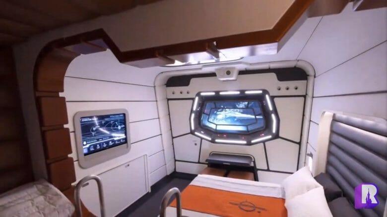 Outra visão de um dos quartos do novo hotel de Star Wars, com beliche e uma cama de casal. Ele tem janelas interativas que mostram o espaço.