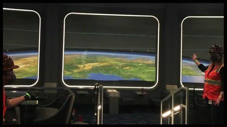 Imagem de como será o interior do Space 220, imitando uma nave espacial com a Terra vista pelas janelas
